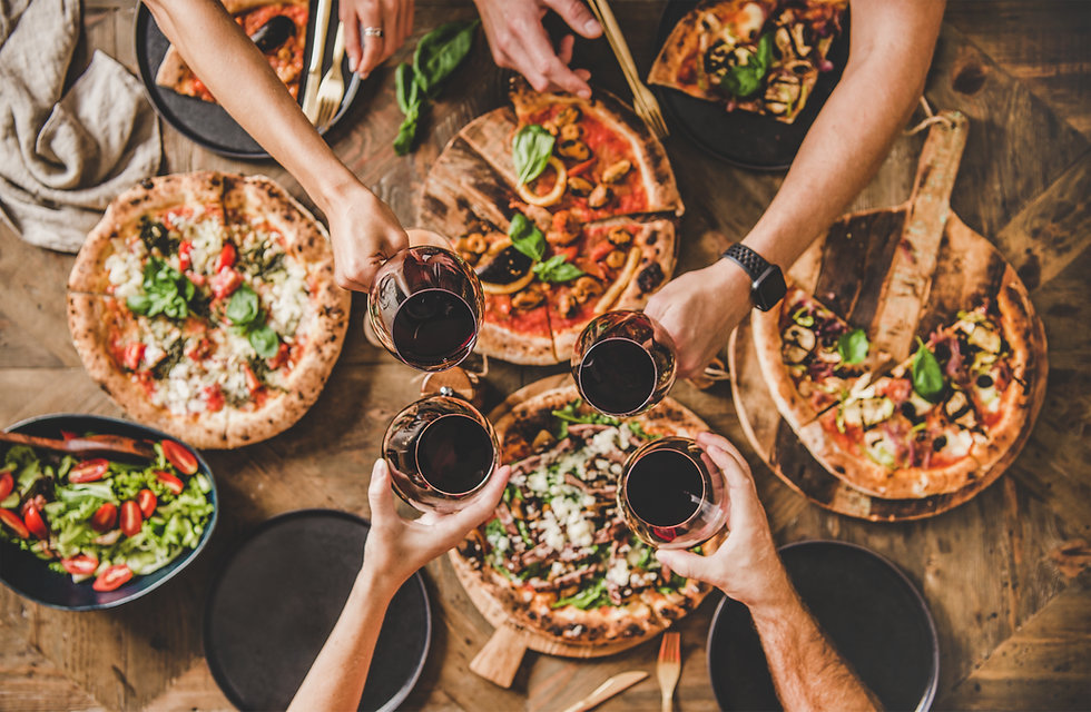 Family or friends having pizza party din
