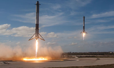 Falcon-Heavy-side-booster-landings-Space