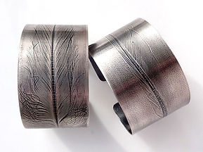 Feather Bangles, fine silver, 35mm wide.