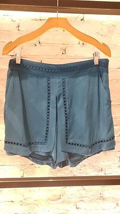 Shorts saia c/renda