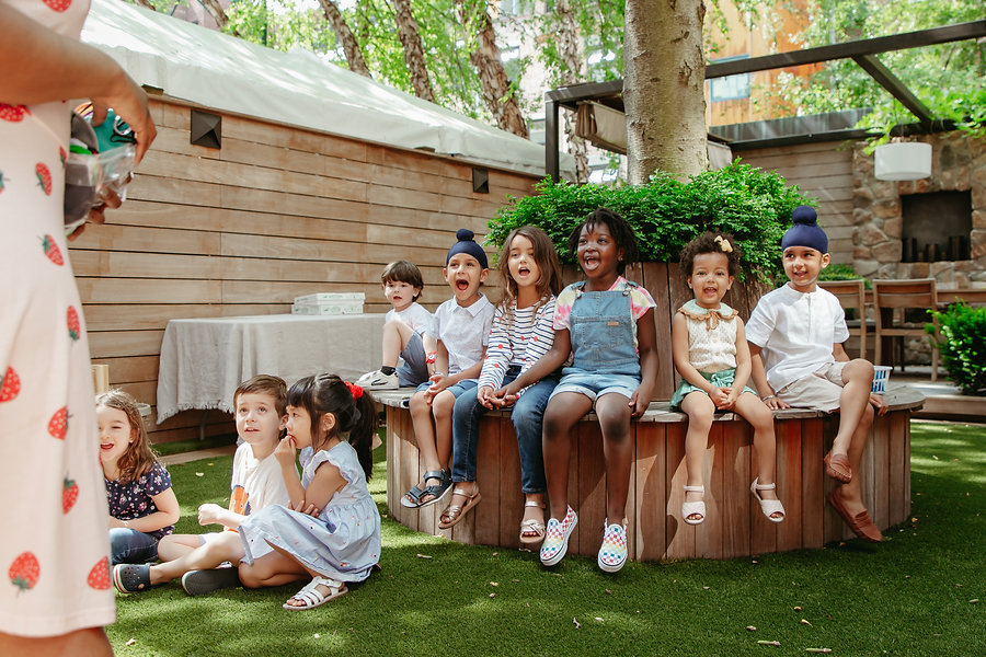 Children in outdoors learning about strawberries