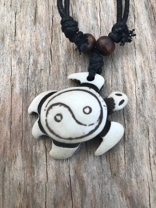 White resin turtle with yin yang shell necklace
