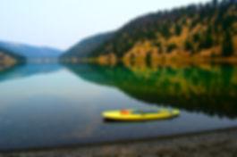 Serene lake wit paddleboard