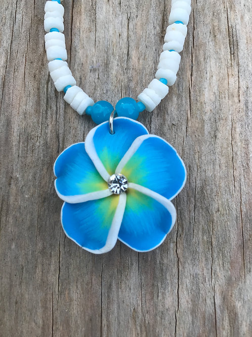 Fimo flower necklace on smooth puka strand