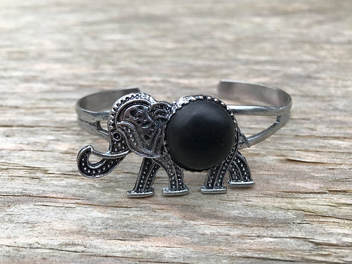Walking elephant cuff bracelet with black faux stone