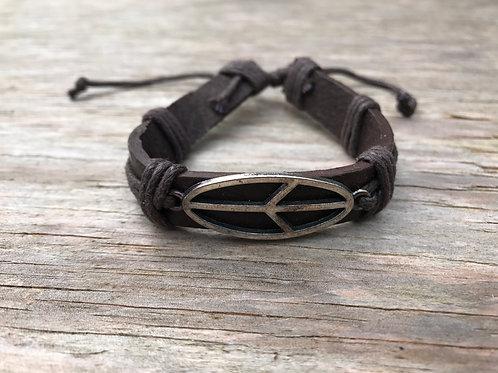 silver colored peace leather bracelet