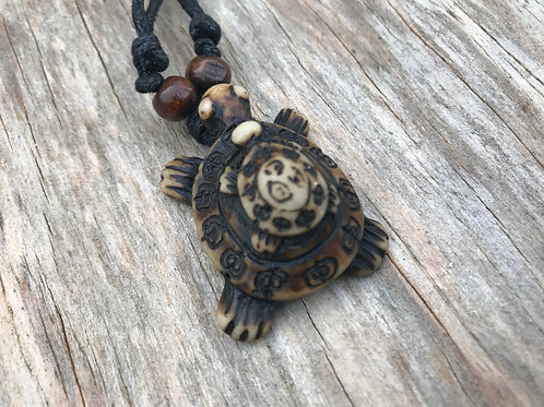 Resin turtle necklace with small turtle on back