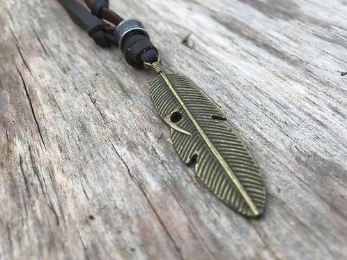 Brass realistic feather on brown leather necklace
