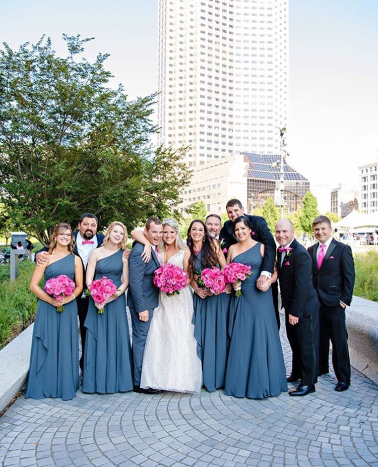 Beautiful dusty blue bridesmaids dresses for a summer wedding in the city!