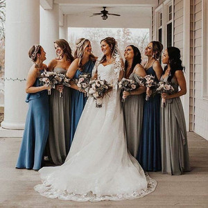 Evaline's Bride in her couture wedding gown and veil surrounded by bridesmaids.