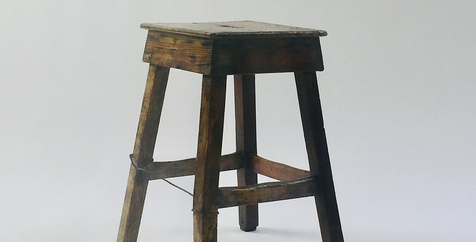 Primitive rustic wooden stool