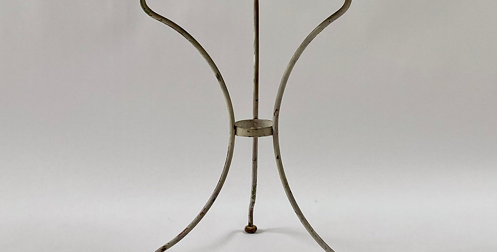 Petite early 20th century white French bistro table with three shapely wrought-iron legs