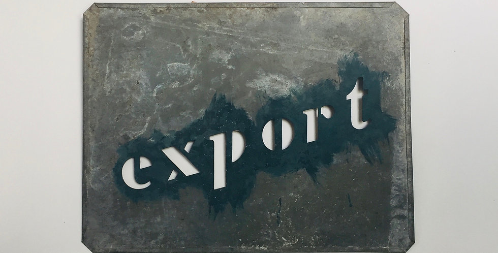 Vintage industrial metal stencil of the word Export with remnants of old paint