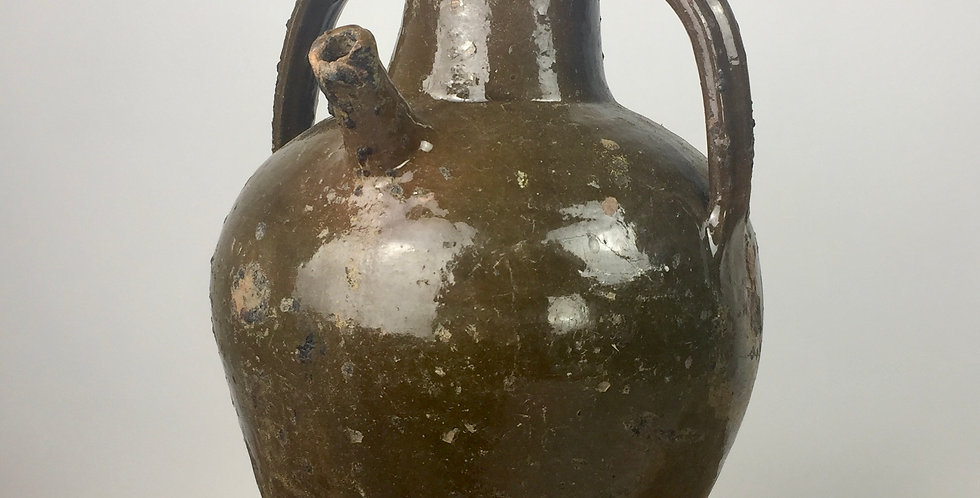 Lovely French 19th century earthenware oil vessel with original green glaze.