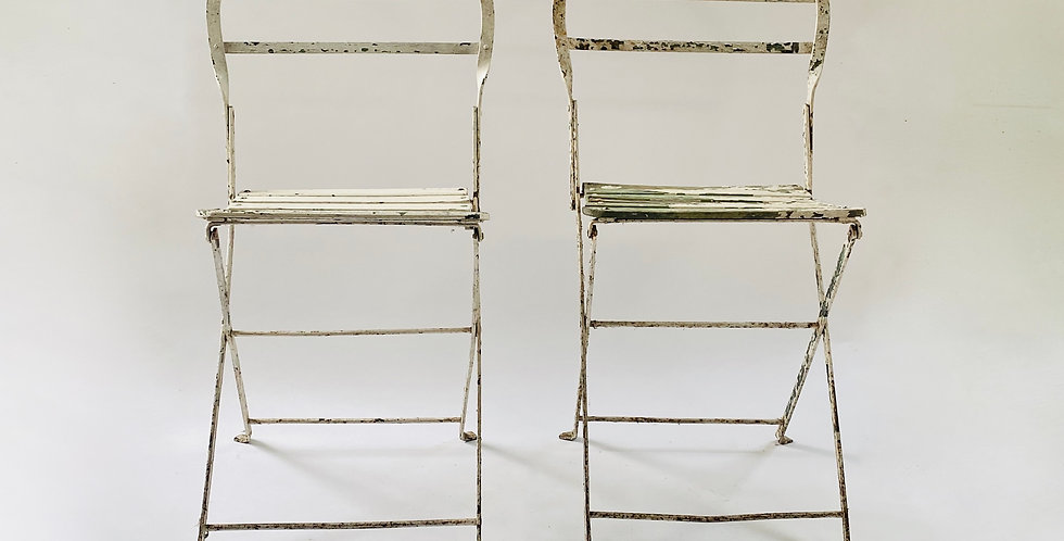 Pair of vintage white metal folding French garden chairs