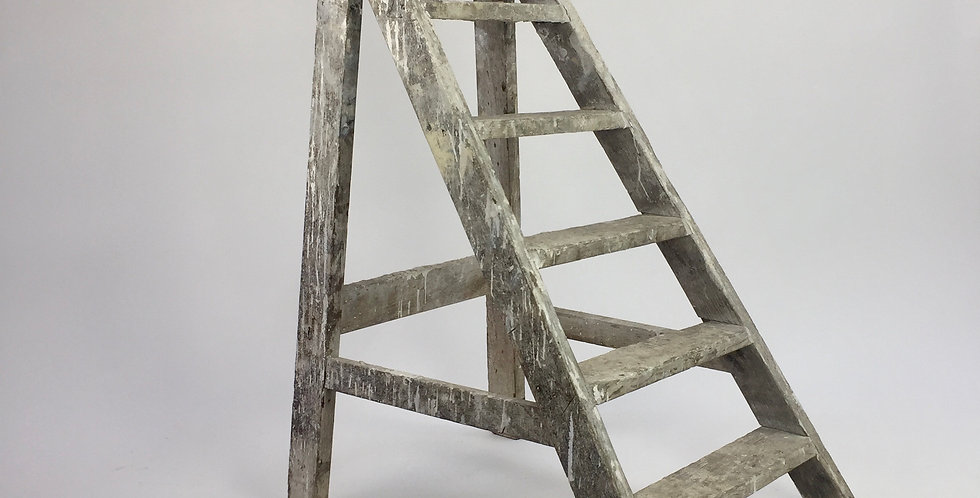 Vintage fixed wooden artist studio step ladder with many layers of old white paint creating a wonderful patina