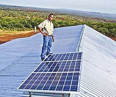 Lucas-on-roof-with-Solar-Panel-Feb-2012-