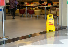 yellow-plastic-cone-with-sign-showing-warning-wet-floor-restaurant-department-store.jpg, reduce liability