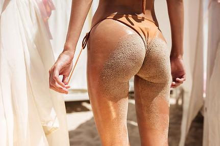 beautiful-woman-body-from-back-in-beige-