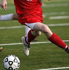 man-in-red-nike-jersey-shirt-playing-soc