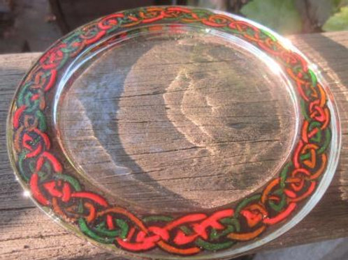 Glass coaster - hand painted Celtic Twist in red, green & orange