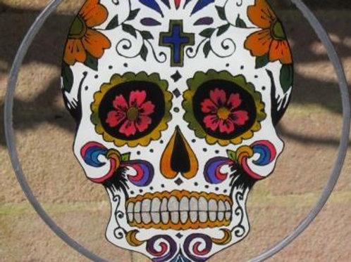 Sugar Skull Suncatcher with pink flowers in eye sockets and cross