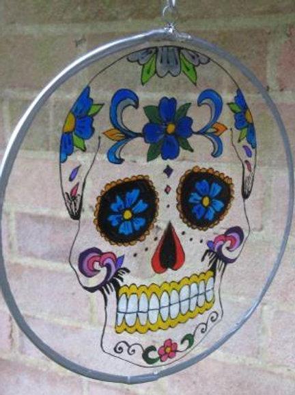 Sugar Skull Suncatcher with blue flowers in eye sockets - clear
