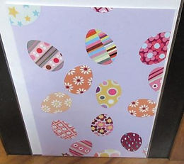 Card with patterned eggs on mauve background