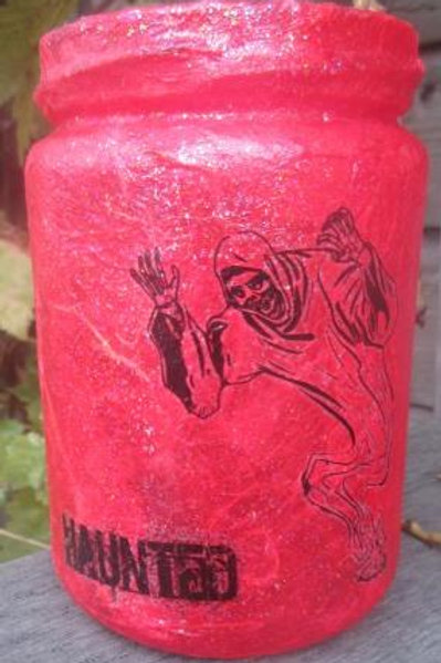 Glass Jar with Ghoul and Haunted on red background