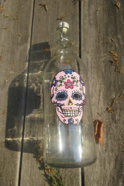 Hand painted sugar skull in pink on bottle with stopper