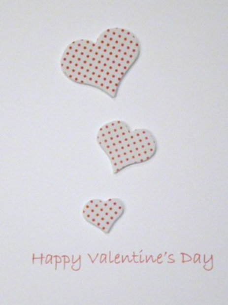 Valentine's Day Card with three red spotted hearts