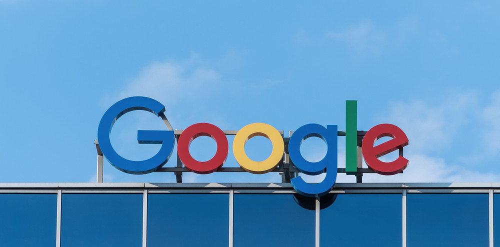 Google Sign on Building with Blue Sky