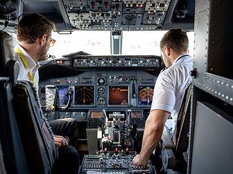 two-pilots-sitting-inside-plane-2064123_