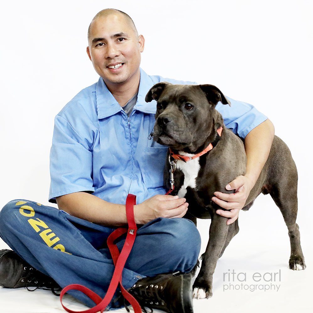 Paws For Life trainer with adopted dog