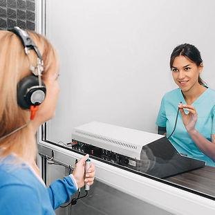 bigstock-Audiologist-Doing-Hearing-Test-