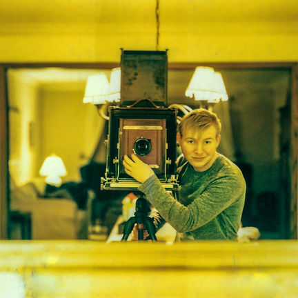Artist portrait with old film camera