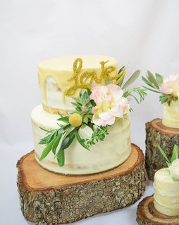 #weddingcakewednesday I just love this fresh floral arrangement on this cake! Lisianthus, rosemary, thyme, olive branches and some sneaky su