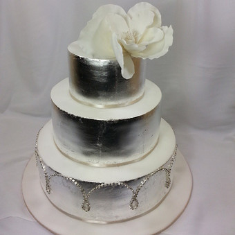 Gorgeous silver leaf and magnolia wedding cake. Adapted from the hugely talented Faye Cahill's beautiful gold cake.jpg