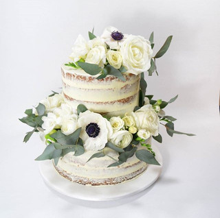 Gorgeous  fresh florals once again from _hayfeverflowers on this semi naked cake for lovely _xoxoevents_ isn't she pretty_  #cakeladycakes #