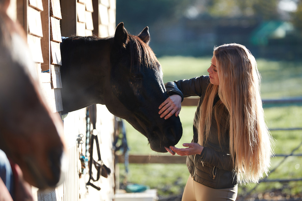 Jess and horses photographed at their stables in Essex
