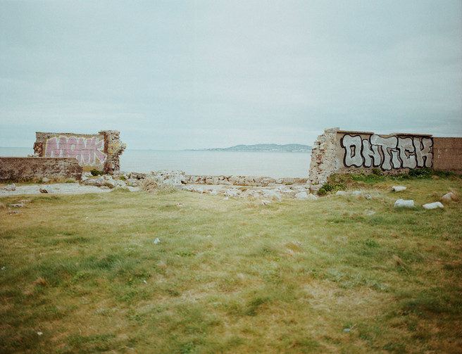 Graffiti and a broken wall, Dublin.