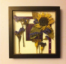 Handpicked flowers from a Matron of Honor's bouquet were dried and framed for a lovely keepsake.
