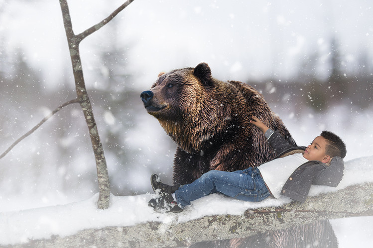 boy pets bear winter muskoka