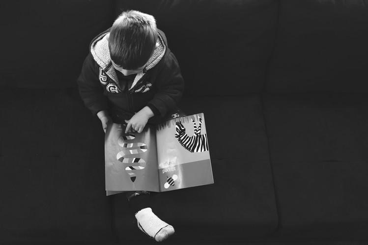 child reads artistic portrait