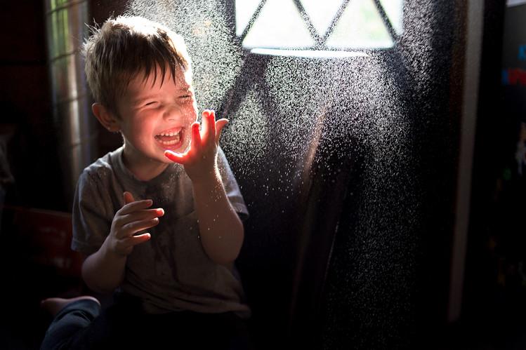 having fun with water splash child photography bewilder