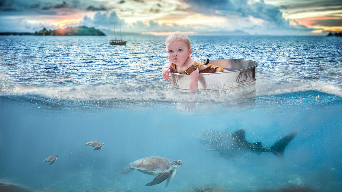 baby floating in a bucket at sea