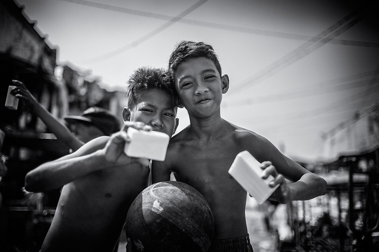 Children posing with soap bar   Soap Cycling