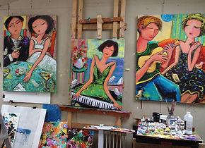 cindy in a group of paintings.jpg