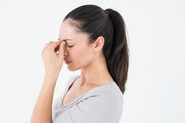 Woman having tension headache