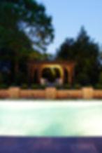 Pool, bluestone deck, brick wall with medallions